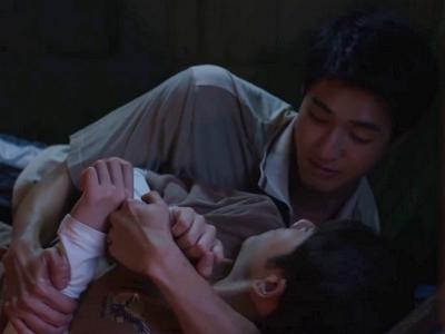 Tian gives Phupha a back massage.