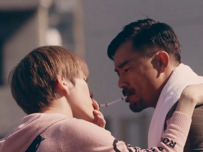 Kohei and Yuta share an intimate moment while smoking cigarettes.