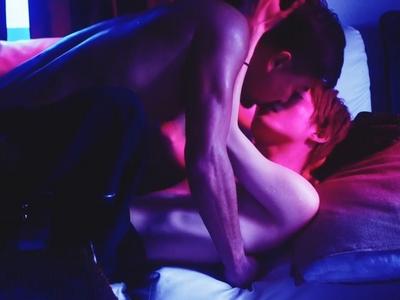 Kohei and Yuta have sex in a neon purplish light.