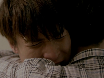 Ait gives Bas a hug after hearing his confession.