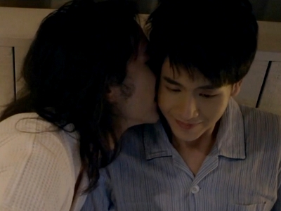 James gives Ait a kiss in bed.