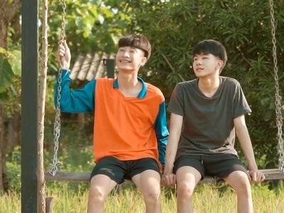 Nabdao and Keptawan share a hug on the swing.
