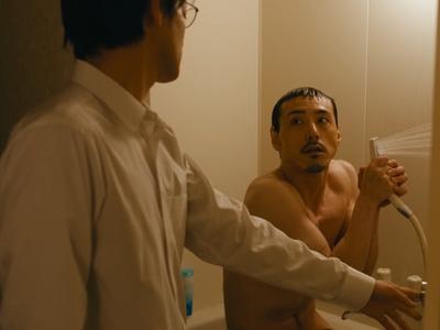 Kido is shirtless when Kijima walks in on him in the bathroom.