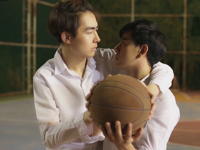 Satha teaches Nut how to play basketball.