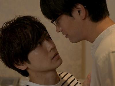 Kijima and Kuzumi have a heated exchange in the love hotel.
