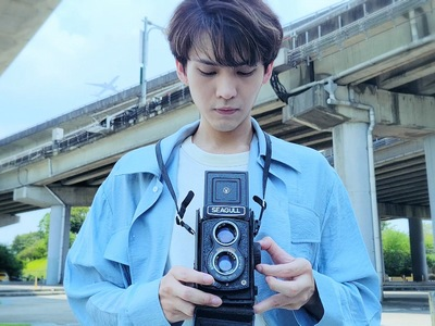 Bo Chun is finally reunited with his beloved camera in the ending.