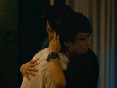 Kijima gives Kuzumi a comforting hug.