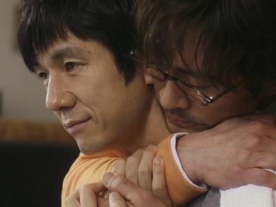 Kenji and Shiro embrace in Episode 12.