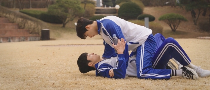 Tae Joo pins Kang Gook on the ground after the dodgeball game.